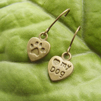 Love my dog paw and stamped word earrings