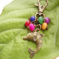 Dolphin handbag charm with red green blue yellow rainbow beads