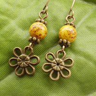 Flower charm earrings with banana yellow glass beads