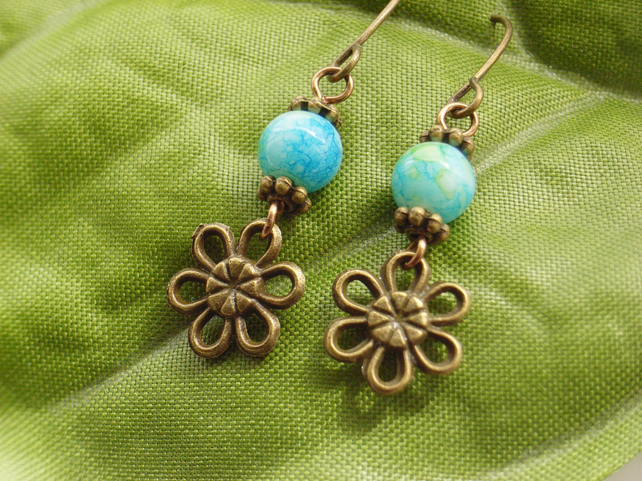 Flower charm earrings with dark turquoise blue glass beads