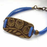 Bracelet owls with blue cord strrap