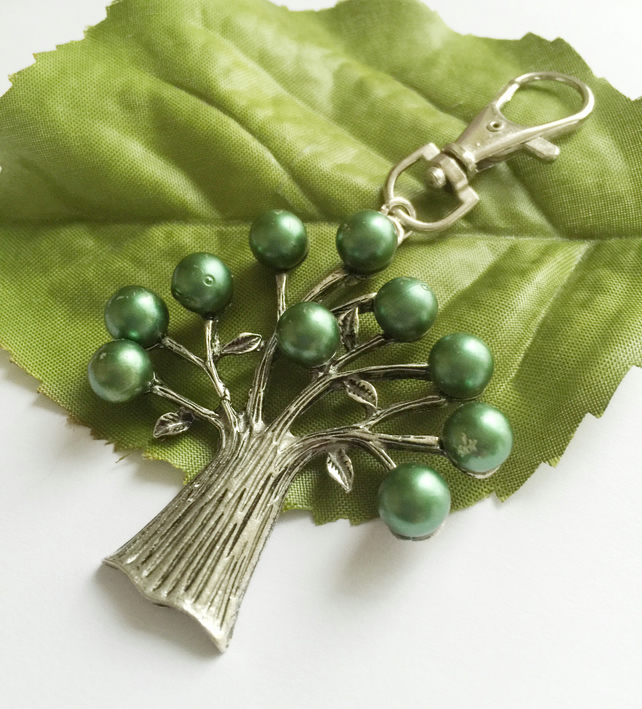 Silver tone bag charm tree with green faux pearl