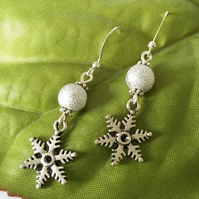 Snowflake charm earrings