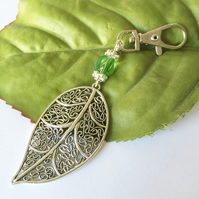 Large leaf statement bag charm with green glass bead
