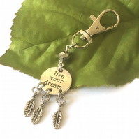 Live your dream stamped word bag charm with feathers