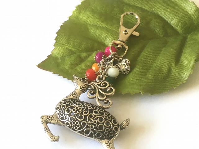 Prancing fancy deer bag charm with heart charm