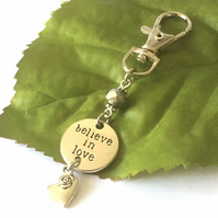 Silver disc Believe in Love stamped bag charm with heart