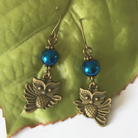 Steampunk style owl earrings with dark blue beads