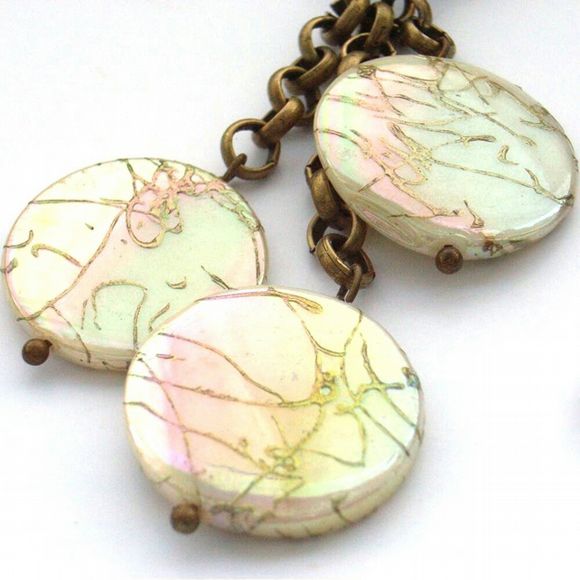 Bag charm or purse charm with mother of pearl coins