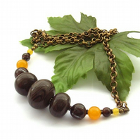 Necklace petrified wood, bronzite, jade and agate gemstone