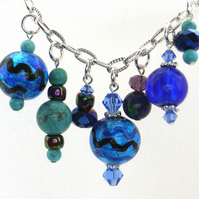 Blue bead charm necklace