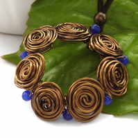 Ring of rose wire pendant blue beads necklace