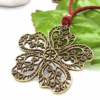 Vintage style filigree flower charm cord necklace