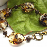 Glass bead and bronzite bracelet