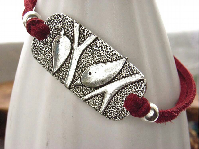Two silver birds charm bracelet red faux suede cord