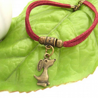 Vintage style bronze dog charm bracelet on red faux suede cord