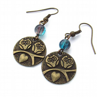 Earrings two bronze owls blue glass beads