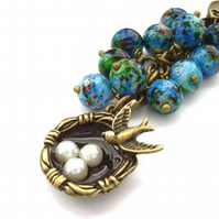 Bag charm bird nest blue beads