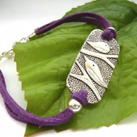 Bird charm cord bracelet purple