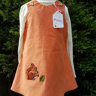 Age: 3-4y. Pumpkin baby needlecord pinafore dress.