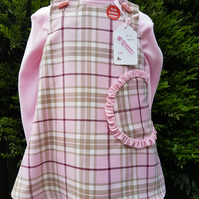 Age: 2-3y. Pink check tartan lined pinafore dress.