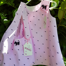 Pale pink scottie cotton dress and bag set. Age: 1-2 years.