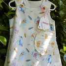 Cream bear and donkey pattern cotton dress. Age: 2-3 years.