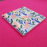 Ceramic floral coaster with cork backing. 10 x 10 cm