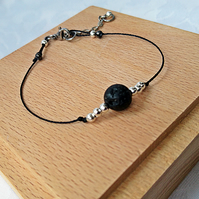 Simple lava bead bracelet, black cord layering bracelet with extension chain.