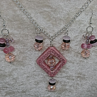 Pink crackle glazed stone pendant with matching earrings