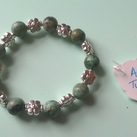 Childrens African Turquoise and flower spacer bracelet
