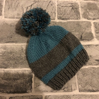 Hand Knitted Stripy Blue And Grey Aran Baby Pom Pom Hat - Various Sizes