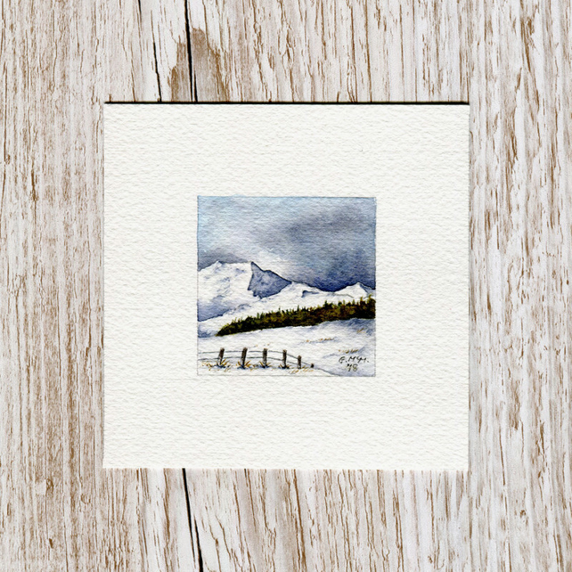 Original watercolour miniature painting of Scotland's hills in the snow