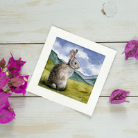 Original Watercolour Miniature painting of a rabbit sitting in the countryside