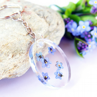 oval resin keyring with real forget me not flowers