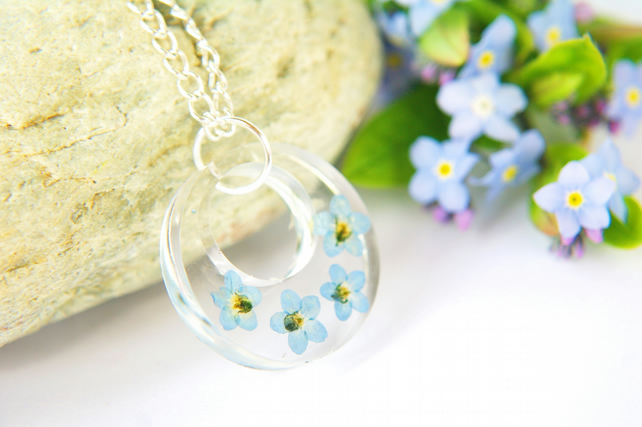 botanical terrarium necklace with real forget me not flowers for nature lovers