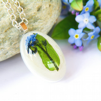 nature inspired resin necklace with real forget me not flowers