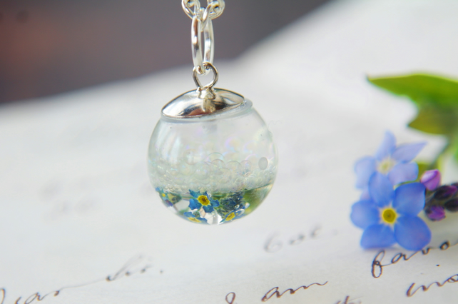 fairy necklace with magic bubbles and forget me not flowers