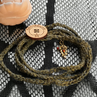 Green Wrap Bracelet with Oak Leaf and Acorn Charm.