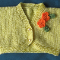 "Hand knitted baby bolero - lemon with crochet flower trim to fit 18"" chest"