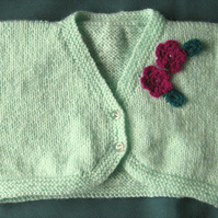 "Hand knitted baby bolero - mint with crochet flower trim to fit 22"" chest"