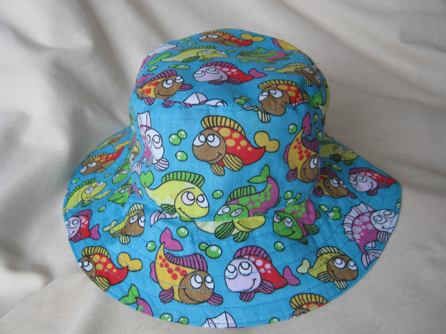 Kids' bucket style sunhat in turquoise fish print - approx 6 to 9 yrs