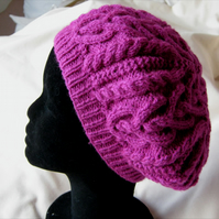 Hand knitted raspberry pink Celtic heart cable pattern beret
