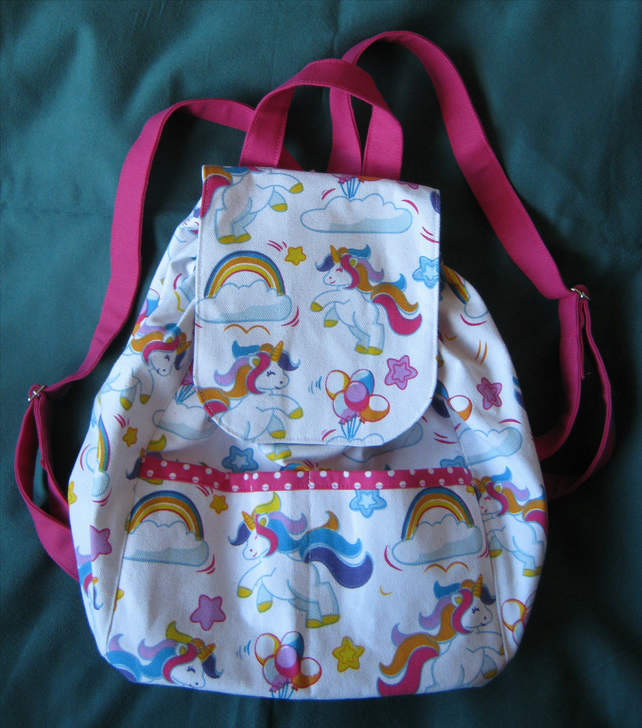 White and cerise unicorn design cotton canvas fabric small backpack with pockets