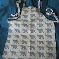 Cook's apron in elephant print cotton fabric with adjustable neck strap