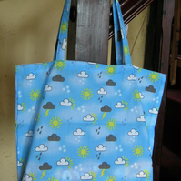 Folding shopping tote bag with zipped carrying pouch - blue and white weather