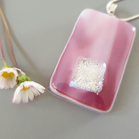 Pink fused glass pendant with dichroic sparkle