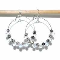 Flower hoop earrings with iridescent glass tears