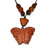 Goldstone butterfly glass wood and cord necklace