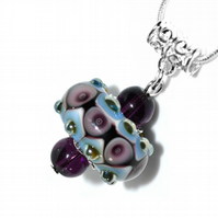 Harlequin pattern lampwork glass necklace